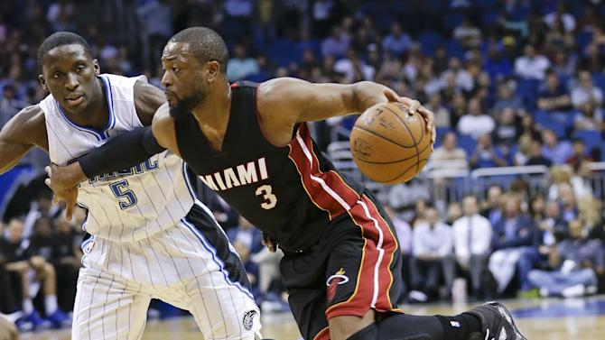 FILE - IN this Feb. 25, 2015, file photo, Miami Heat's Dwyane Wade (3) goes to the basket past Orlando Magic's Victor Oladipo (5) during an NBA basketball game in Orlando, Fla. A person familiar with the negotiations says Wade is staying with the Heat. The person says Wade informed the Heat on Thursday, July 2, 2015, he will accept a one-year offer to re-sign for $20 million for next season. The person spoke to The Associated Press on condition of anonymity because no NBA deals can be finalized this summer until July 9.(AP Photo/John Raoux, File)