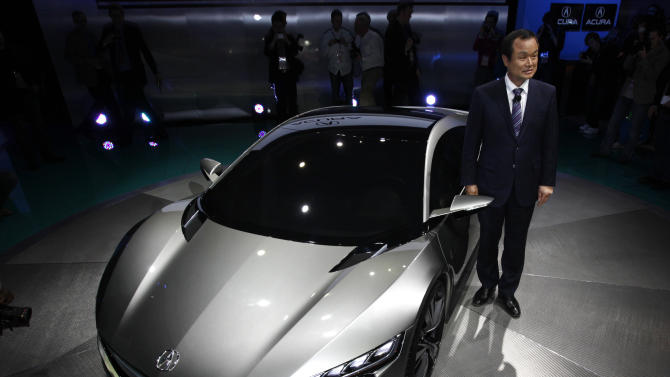Takanobu Ito, President and CEO, Honda Motor Co., Ltd. stands with the Acura NSX Concept, at the North American International Auto Show in Detroit, Monday, Jan. 9, 2012. (AP Photo/Paul Sancya)