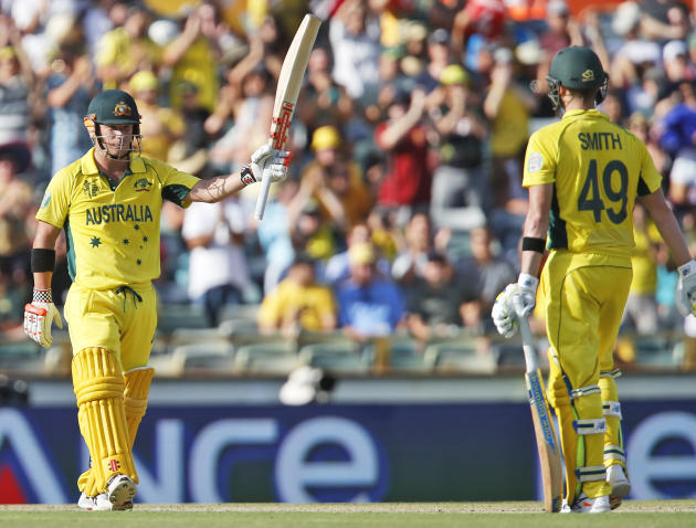 Australia's David Warner celebrates after scoring 150 runs during their Cricket World Cup Pool A match against Afghanistan in Perth, Australia, Wednesday, March 4, 2015. (AP Photo Theron Kirkman)