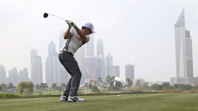 Golf - McIlroy retains Dubai lead, Woods toils