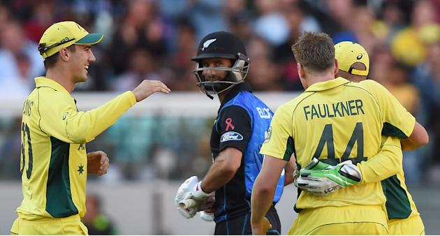 New Zealand's Grant Elliott looks at Australia's James Faulkner's on whose bowling he was dismissed during the ICC Cricket World Cup final in Melbourne, Australia, Sunday, March 29, 2015. (AP