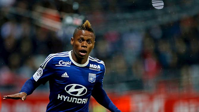 Clinton Nje of Olympique Lyon celebrates his goal during their French Ligue 1 soccer match against Reims at the Gustave Delaune Stadium in Reims
