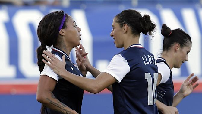United States' Sydney Leroux, left, is congratulated by teammate Carli Lloyd (10) after Leroux scored against Russia during a friendly  international soccer match in Boca Raton, Fla., Saturday, Feb. 8, 2014. The U.S. won 7-0