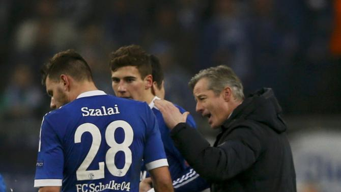 Schalke 04's coach Keller celebrates with Szalai and Draxler after their Champions League group E soccer match against FC Basel in Gelsenkirchen