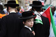 Orthodox Jewish pro-Palestinian demonstrators march through central London to call for an end to Israeli military action in Gaza