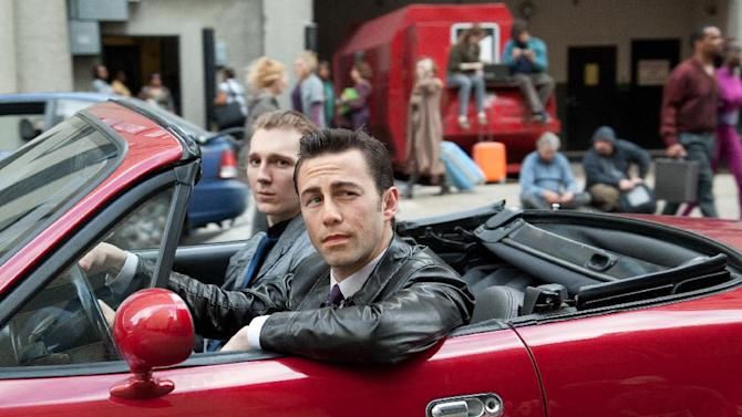 """This film image released by Sony Pictures shows Joseph Gordon-Levitt, foreground, and Paul Dano in a scene from the action thriller """"Looper."""" For its 37th year, The Toronto International Film Festival opens with a big Hollywood action film, the sci-fi tale """"Looper,"""" starring Bruce Willis, Joseph Gordon-Levitt and Emily Blunt. (AP Photo/Sony Pictures Entertainment, Alan Markfield)"""