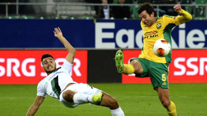 FC St. Gallen's Goran Karanovic, left, and Kuban Krasnodar's Angel Dealbert, right, fight for the ball during their UEFA Europa League Group A  soccer match between Switzerland's FC St. Gallen and Russia's Kuban Krasnodar at the AFG Arena in St. Gallen, Switzerland, Thursday, Sept. 19, 2013