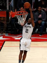 Kawhi Leonard of the San Antonio Spurs and Team Chuck dunks the ball in the first half in the BBVA Rising Stars Challenge 2013, part of the 2013 NBA All-Star Weekend, at the Toyota Center in Houston, Texas, on February 15, 2013
