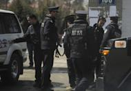 Armed Chinese police get ready to patrol a street in the county town of Banma in China's northwest Qinghai province on March 10. A young Tibetan man who set himself alight in June as part of a wave of self-immolations in protest at Chinese rule in Tibet has died from his injuries, an India-based rights group said Thursday