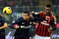 Fredy Guarin (left) fends off AC Milan's Kevin Constant in a Serie A game at San Siro Stadium in Milan on December 22, 2013