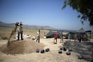 Volunteers of the Hebrew University work during an excavation at the northern Israeli archeological site of the ancient Tel Hazor on July 9 2013
