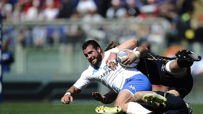 Italy's Robert Barbieri (L) is tackeld by Scotland's Richie Gray during their Rugby Union Six Nations match at the Rome's Olympic stadium on March 17, 2012. Italy defeated Scotland 13-6.  AFP PHOTO / FILIPPO MONTEFORTE (Photo credit should read FILIPPO MONTEFORTE/AFP/Getty Images)