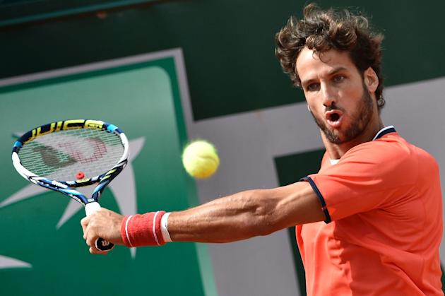 Spain's Feliciano Lopez returns the ball to Russia's Teimuraz Gabashvili during the men's first round of the Roland Garros 2015 French Tennis Open in Paris on May 25, 2015