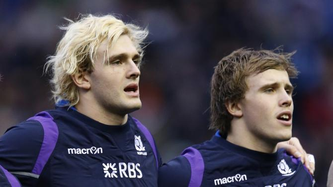 Scotland's Jonny Gray and his brother Richie Gray sing the Flower of Scotland before their rugby union match against South Africa at Murrayfield Stadium in Edinburgh