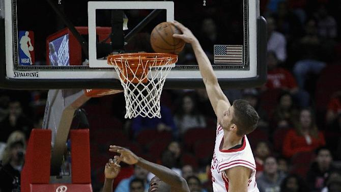 Houston Rockets small forward Chandler Parsons (25) dunks on Orlando Magic shooting guard Victor Oladipo (5) during the first quarter of an NBA basketball game on Sunday, Dec. 8, 2013, in Houston