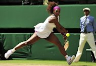 US player Serena Williams plays a double-handed backhand shot during her women's singles semi-final match against Belarus's Victoria Azarenka on day 10 of the 2012 Wimbledon Championships tennis tournament at the All England Tennis Club in Wimbledon, southwest London. Williams and Agnieszka Radwanksa will meet in Saturday's Wimbledon final