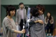 """Family members of missing passengers who were on South Korean ferry """"Sewol"""" which sank at the sea off Jindo cry as they wait for news of their family from a rescue team, at a gym in Jindo April 17, 2014. REUTERS/Kim Hong-Ji"""