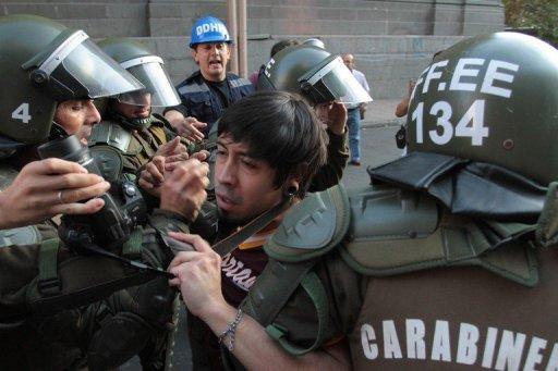 "A demonstrator is arrested by riot police during a march of the Peoples' Summit ""for Social Justice, International Solidarity and in Defence of the Commons"", held on the sidelines of the CELAC-EU Summit, in Santiago on January 25, 2013. Latin American and European leaders open a two-day summit Saturday to give a fresh impetus to efforts to seal a free trade agreement between their two blocs"