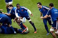"Yannick Nyanga (3rd R) passes the ball to scrum-half Morgan Parra (R) during a training session. ""Even once you are in the France team, you say to yourself 'I don't know how this has happened. Am I going to be able to handle it?' Now I know that I am able to handle it,"" said Nyanga"