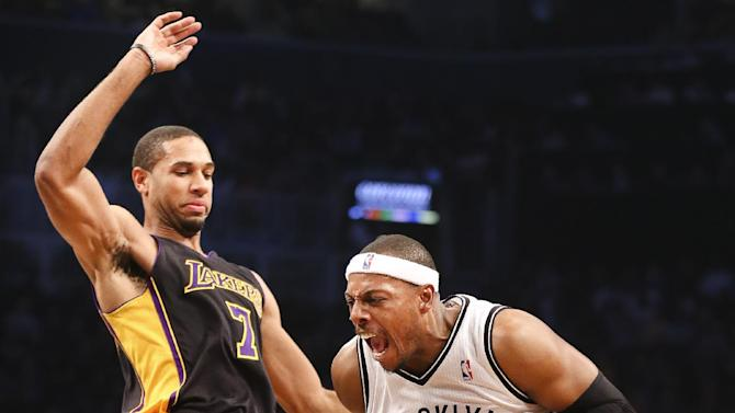 Brooklyn Nets small forward Paul Pierce, right, drives against Los Angeles Lakers small forward Xavier Henry (7) in the second quarter of an NBA basketball game at the Barclays Center, Wednesday, Nov. 27, 2013, in New York