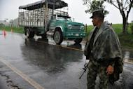 "Colombian soldiers man a checkpoint along a highway of La Montanita municipality, department of Caqueta, Colombia, on May 2, near Union Peneya, where last April 28 French journalist Romeo Langlois disappeared. Between the Andes and the Amazon jungle, in a rebel stronghold called ""the red zone,"" Langlois has become ensnared in Latin America's oldest armed conflict"