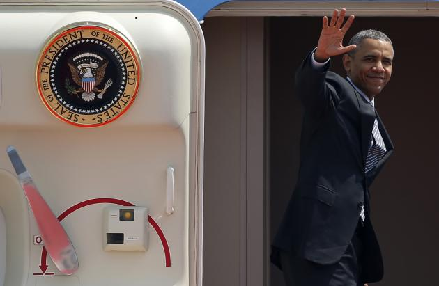 U.S. President Barack Obama waves from Air Force One as he departs Haneda International Airport in Tokyo