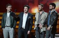 Mumford & Sons, winners for Best Album of the Year, react on stage at the Staples Center during the 55th Grammy Awards in Los Angeles, California, February 10, 2013