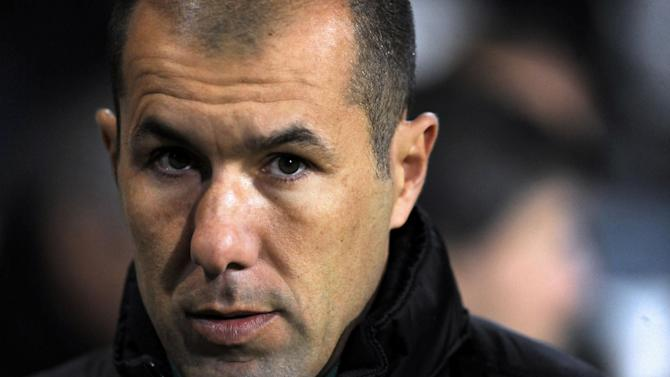Sporting Lisbon's coach Leonardo Jardim reacts on the sideline prior to their 2-0 victory over Gil Vicente in a Portuguese League soccer match at the Cidade de Barcelos stadium, Barcelos, northern Portugal, Sunday, Dec. 8, 2013. Sporting leads the championship ahead of rivals FC Porto and Benfica