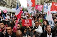Supporters of Socialist Party (PS) candidate Francois Hollande wait for results of the second round of the presidential election outside the party' s headquarters in Paris