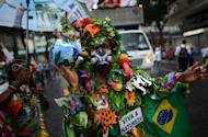 "An activist with a Brazilian national flag and a sign reading ""Long live nature"" takes part in the ""Global March"" in Rio de Janeiro, Brazil, in the framework of the UN Rio+20 Conference on Sustainable Development"