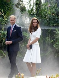 Prince William (L) and his wife Catherine, the Duchess of Cambridge, tour the Cloud Forest at Singapore's Gardens by the Bay on September 12. The couple planted a sapling in the Colonial Garden section