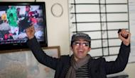 Agence France-Presse (AFP) photographer Massoud Hossaini reacts as he sees his photograph reproduced on Afghan television at the AFP office in Kabul. It is a picture of pure horror that is difficult to look at. Hossaini's gut-wrenching image of an Afghan girl crying in fear after a suicide bomber's attack last December on Monday won the Pulitzer Prize for breaking news photography