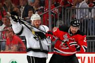Los Angeles Kings' Colin Fraser (L) and New Jersey Devils' Marek Zidlicky fight for position during game one of their NHL Stanley Cup Final on May 30. Fraser gave the Kings the lead in the first period