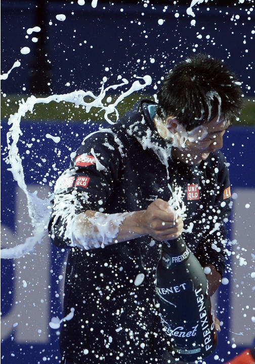FILE - In this Sunday, April 26, 2015 file photograph, Kei Nishikori of Japan sprays champagne after winning the Barcelona Open tennis tournament in Barcelona, Spain. Nishikori defeated Spain's Pa
