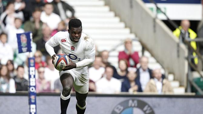 England's right wing Christian Wade runs to score a try during their rugby union match against Barbarians, at Twickenham Stadium in south-west London, on May 31, 2015