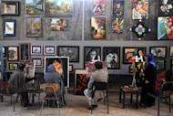 Afghan youths learn how to paint at the Behzad Art Gallery in Herat. A call by Afghan President Hamid Karzai for more foreign involvement in the country's higher education system risks exacerbating an already dangerous brain drain, analysts warn