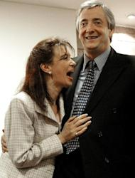 Argentine presidential candidate Nestor Kirchner laughs with his wife, Senator Cristina Fernandez, at the House of Santa Cruz, in Buenos Aires, 13 May, 2003. Christina succeeded Nestor in 2007 after his death, but the decade-old Kirchner rule is showing its age