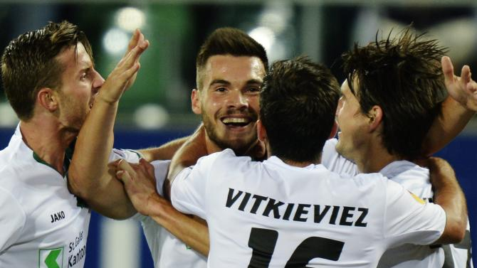 FC St. Gallen's Goran Karanovic, center, celebrates with teammates after scoring the opening goal during the UEFA Europa League Group A soccer match between Switzerland's FC St. Gallen and Russia's Kuban Krasnodar at the AFG Arena in St. Gallen, Switzerland, Thursday, Sept.19, 2013