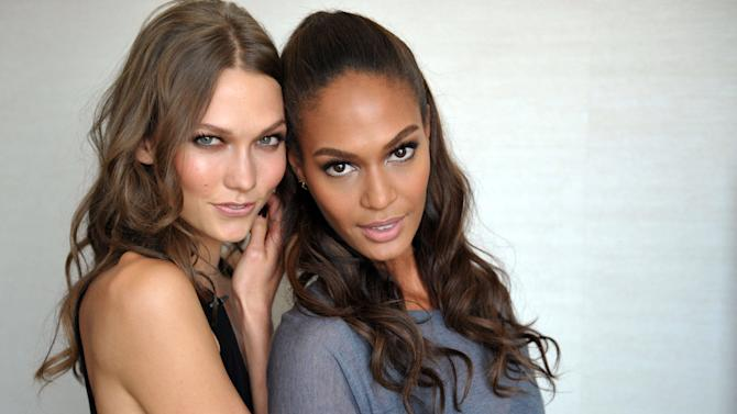 """Models Karlie Kloss and Joan Smalls pose for a photograph on Sept. 4, 2012 in Los Angeles, Calif.  The """"House of Style"""" that MTV built back in 1989 has undergone some serious renovation, but it always had good bones. The show's past and present come together in a documentary called """"House of Style: Music, Models, and MTV"""" that makes its televised premiere on Saturday.(Photo by John Shearer/Invision for MTV.com/AP Photo)"""