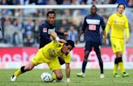 Dortmund's Lucas Barrios (front) and Hertha Berlin's Raffael and during their German league match on February 18. Dortmund picked up their sixth straight league win with a hard-earned victory 1-0 against a Hertha side just above the relegation places