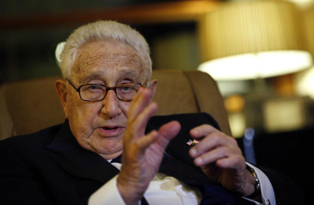 Former U.S. Secretary of State Henry Kissinger speaks to reporters after paying his respects to the late Lee Kuan Yew, Saturday, March 28, 2015, in Singapore. Lee, 91, died Monday at Singapore General