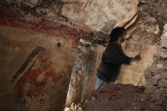 Archaeologist William Saturno of Boston University carefully uncovers art and writings left by the Maya some 1,200 years ago. The art and other symbols on the walls may have been records kept by a scribe, Saturno theorizes.