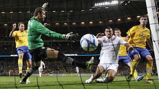 Steven Caulker scores on his England debut in the 4-2 defeat to Sweden at the Friends Arena, Stockholm