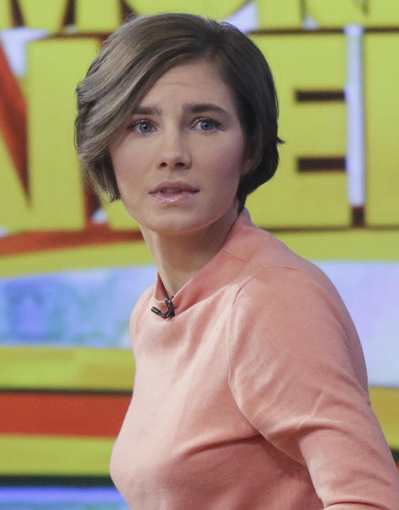 Amanda Knox prepares to leave the set following a television interview, Friday, Jan. 31, 2014 in New York. Knox said she will fight the reinstated guilty verdict against her and an ex-boyfriend in the