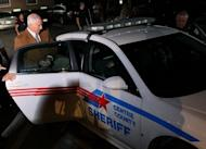 Former Penn State assistant football coach Jerry Sandusky is led into a police car in handcuffs after being convicted in his child sex abuse trial at the Centre County Courthouse in Pennsylvania on June 22. Sandusky stood accused of molesting 10 boys over a 15-year period
