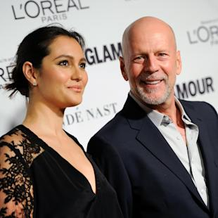 "FILE - In this Nov. 10, 2014 file photo, Bruce Willis and wife Emma Heming attend the 2014 Glamour Women of the Year Awards at Carnegie Hall in New York. Willis is not saying ""Yippie-ki-yay"" about the cancellation of his latest film. A spokesman for Willis told The Associated Press Friday, Feb. 27, 2015, that production of ""Wake"" was suddenly halted this week when financing fell through, and Willis is concerned that the crew is left jobless. (Photo by Evan Agostini/Invision/AP, File)"