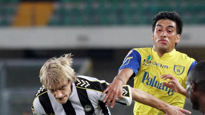Chievo's Marcelo Estigarribia, right, of Paraguay, vies for the ball with Udinese's Dusan Basta, of Serbia, during a Serie A soccer match at the Bentegodi stadium in Verona, Italy, Saturday, Sept. 21, 2013