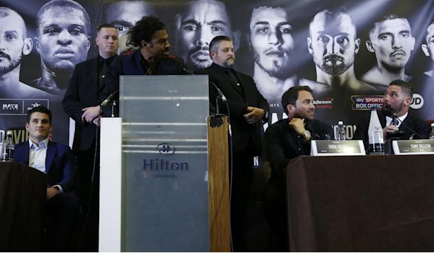 David Haye and Tony Bellew during the press conference as promoter Eddie Hearn looks on