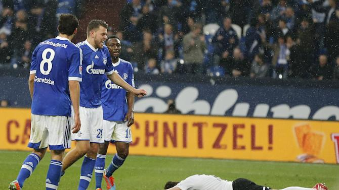 Schalke's Adam Szalai of Hungary, second from left,  celebrates after scoring during the German first division Bundesliga soccer match between Schalke 04 and Eintracht Braunschweig in Gelsenkirchen, Germany, Saturday, March 22, 2014