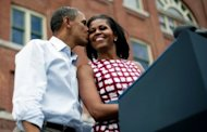US President Barack Obama kisses First Lady Michelle Obama at a campaign event in Dubuque, Iowa, August 15. With charm, hidden steel and growing political skill, Michelle Obama is injecting a timely jolt of verve into her husband's battered political brand